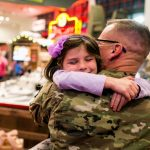 Returning soldier surprises wife and daughter during visit to Santa