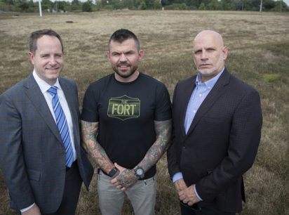 From left are Matt Holbrook, regional partner, St. John Properties, the parcel's developer; Danny Farrar, president and co-founder of Platoon 22 and Michael Meyer, president and CEO of Goodwill of Monocacy Valley, stand on the land that will become home to a 40,000 square foot building that will house Goodwill's headquarters and a Veterans Service center located on Monocacy Boulevard.